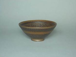 飴釉飛び鉋文茶碗